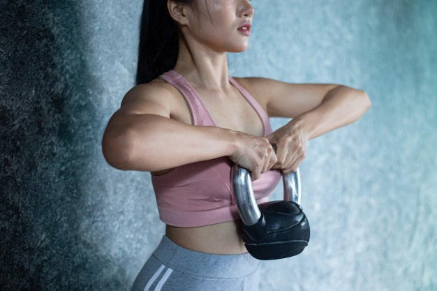 asian woman doing exercise during quarantine