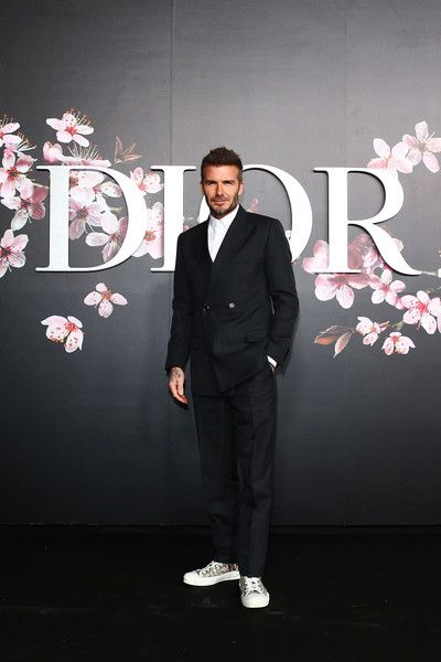 Beckham featured double breasted sans tie, along with Dior kicks