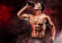 fit man taking bodybuilding supplement