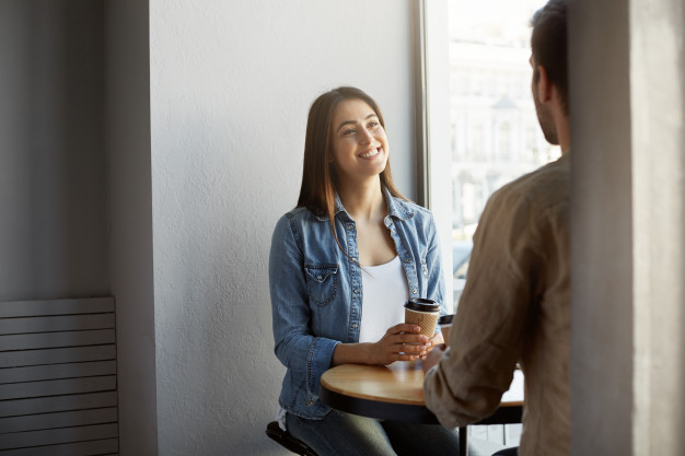 man talking to woman happy compliment