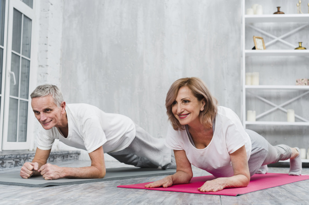old couple performing plank exercise