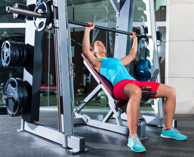 smith machine incline press chest exercise