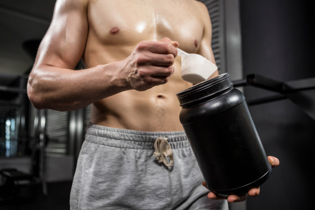 mid-section-shirtless-man-taking-proteins-from-can-fitness - weight maintain
