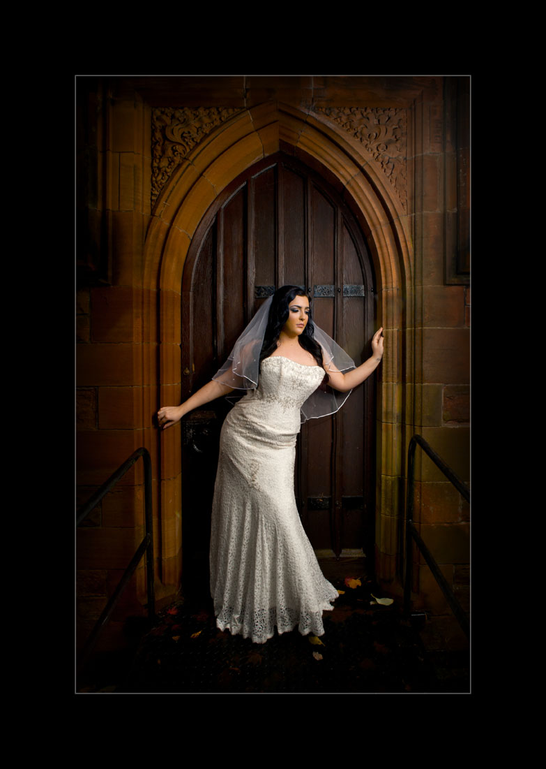 bridal pobridal portrait with bride in the arch door of a church