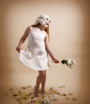 girl with flowers on cream background