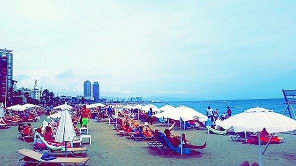 At La Barceloneta Beach, with the other thousands of people.