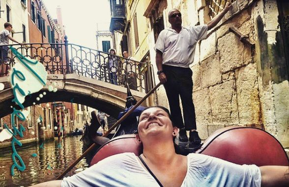 Me, on a gondola in Venice. My gondolier was NOT impressed.