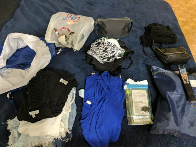 All the things going into the carry-on ( the blue and white in the left corner is the inflatable cooler )