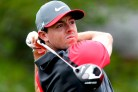 Rory McIlroy of Northern Ireland watches his tee shot on the 10th hole during the first round of the PGA Championship at Valhalla Golf Club in Louisville, Kentucky, August 7, 2014. REUTERS/John Sommers II (UNITED STATES - Tags: SPORT GOLF)