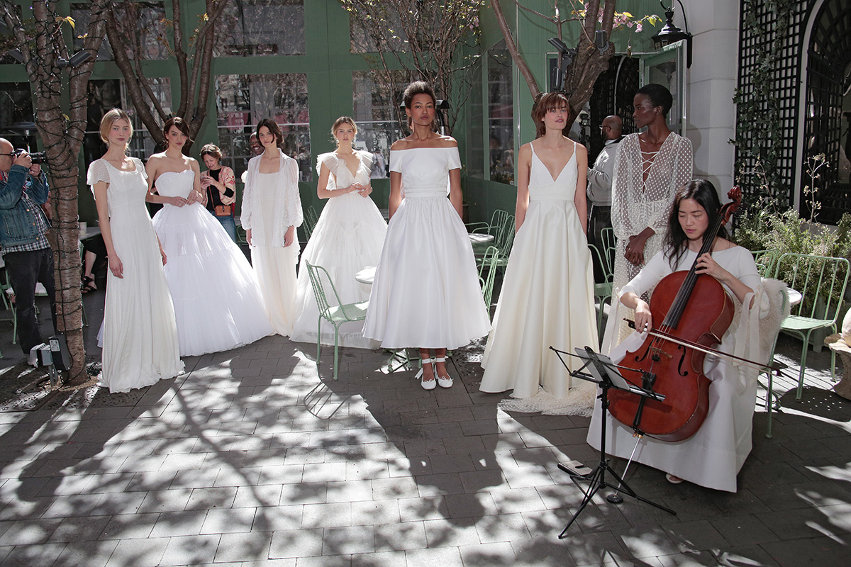 NEW YORK, NY - APRIL 18: Models pose with musician wearing the Delphine Manivet Spring Summer 2017 Bridal Presentation on April 18, 2016 in New York City. (Photo by Randy Brooke/Getty Images for Delphine Manivet)