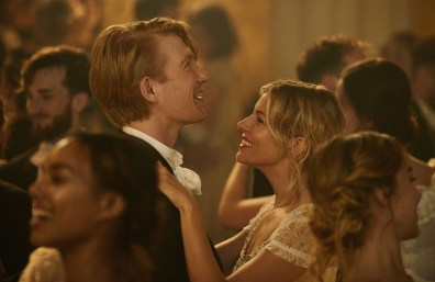 Domhnall Gleeson, as Thomas Burberry & Sienna Miller, as Thomas' fictional first love