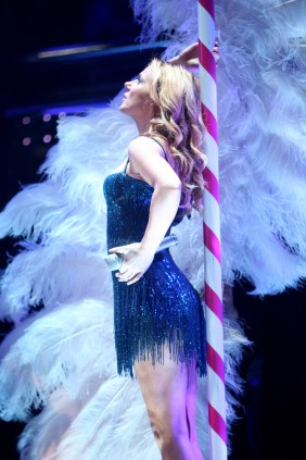 A high resolution portrait of Spice Girl Geri Halliwell on stage.
