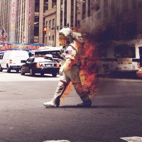 An astronaut, in flames, on 6th Avenue