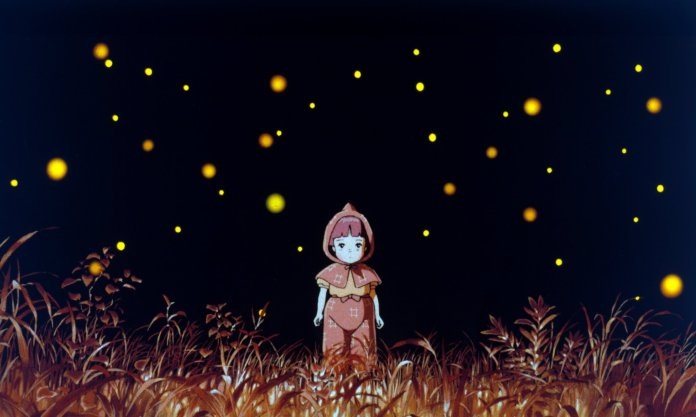 a girl standing amidst fireflies in a field