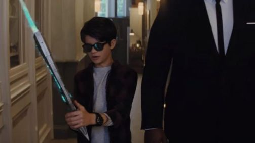 a kid holding a light saber sort of thing