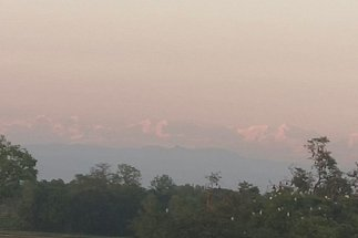 a distant view of mountains and trees