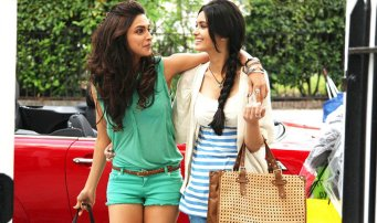 a scene from cocktail showing verona and meera walking hand in hand for filmy friendships