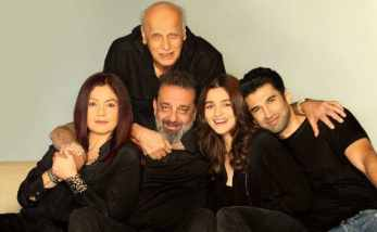 5 people sitting closely on a couch , the caste of the movie sadak 2