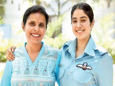 two women standing ans smiling- the real gunjan saxena and jahnvi kapoor playing her role in the biopic