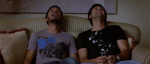 still from the movie wake up sid, two boys sitting, smiling and staring at the ceiling