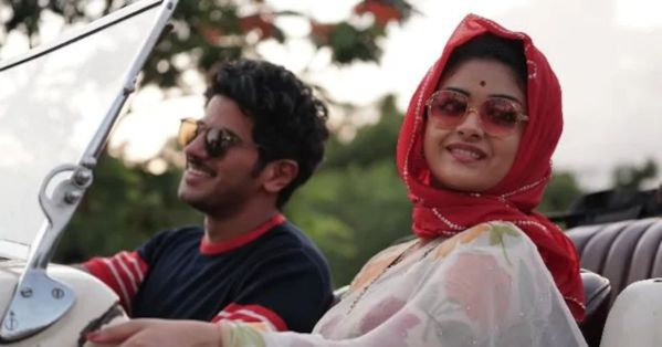 in photo the actors from the movie mahanati sitting in a car in a still from the movie