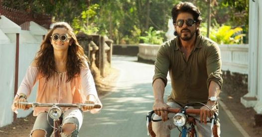 in photo the characters from the movie dear zindagi cycling on a road