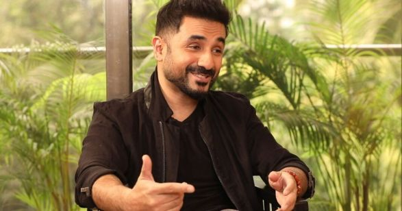 vir das laughing in a still from an interview