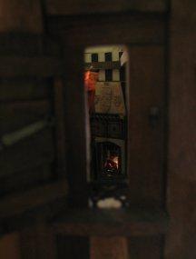 Small outward shutter peek in to fireplace