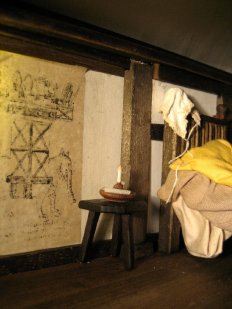 theinfill Medieval, Tudor, Jacobean 1:12 dolls house blog - the infill dolls house blog – boy's bedroom - wall decorations on the left