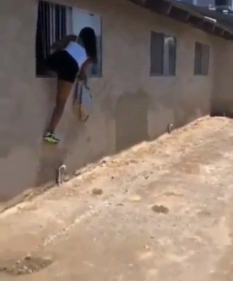 side chick jumping out of window