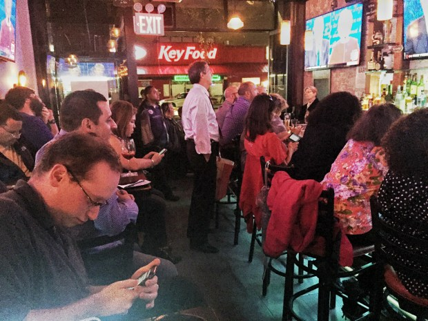 Yeras Sports Bar and Restaurant in Jackson Heights was packed on Monday night as spectators gathered to watch the first presidential debate with the John F. Kennedy Democratic Club of Queens. (Nicole Einbinder/ The Ink)