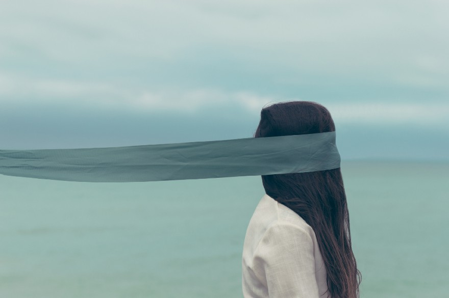 "heart break ""Woman with long hair covered with a blue blindfold in Scarborough"" by Oscar Keys"