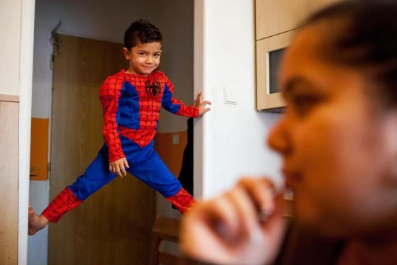 superman roma kid Sebastian Kroscen plays near his mother, Jitka Cervenakova, who works with other mothers to build understanding of their legal rights for enrolling their children in mainstream schools in the city of Ostrava, Czech Republic. Björn Steinz/Panos for the Open Society Foundations