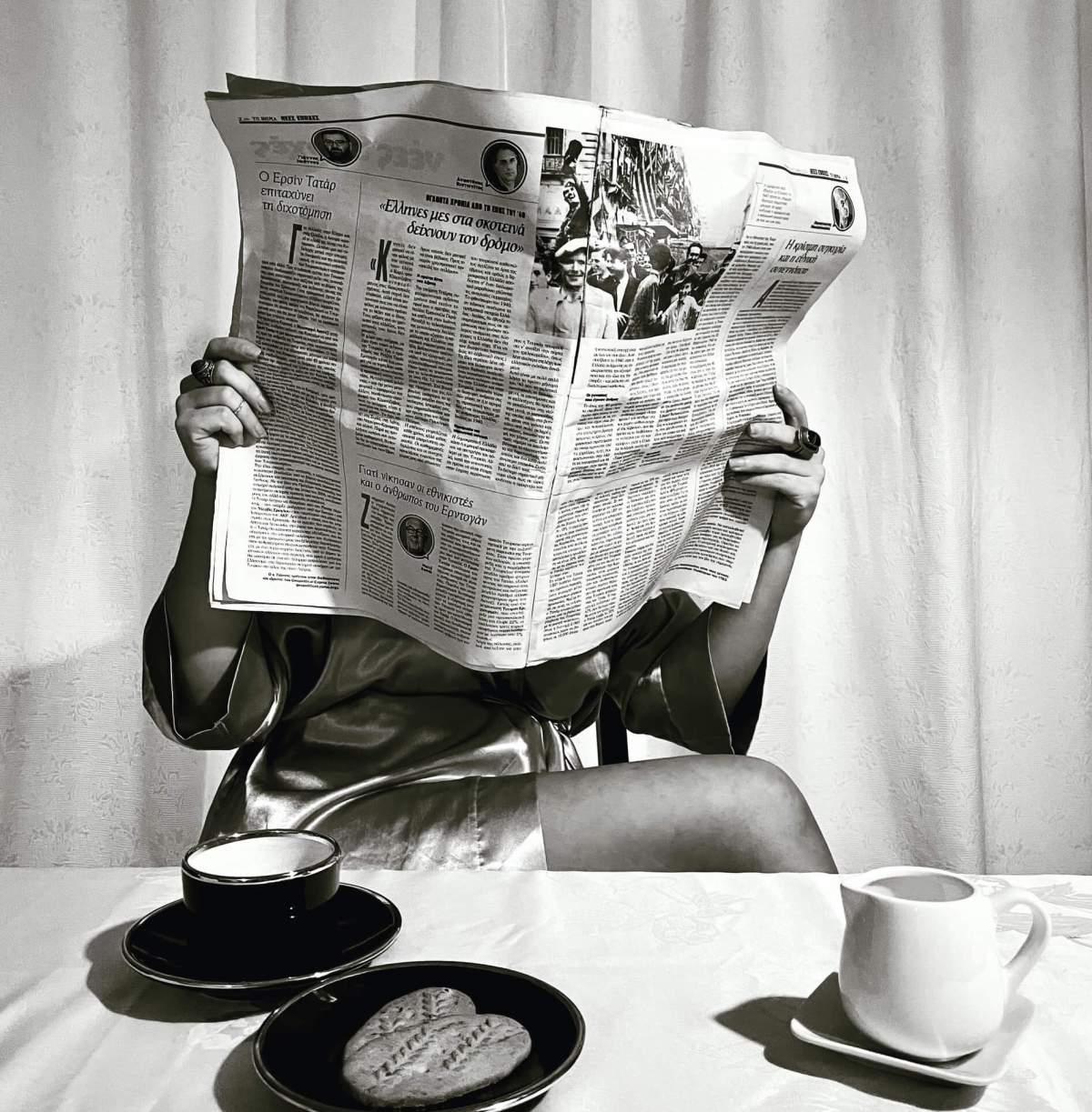 woman reading newspaper on an article about a deputy editor interview