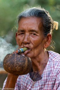 Woman smoking cigar in Bagan, Myanmar