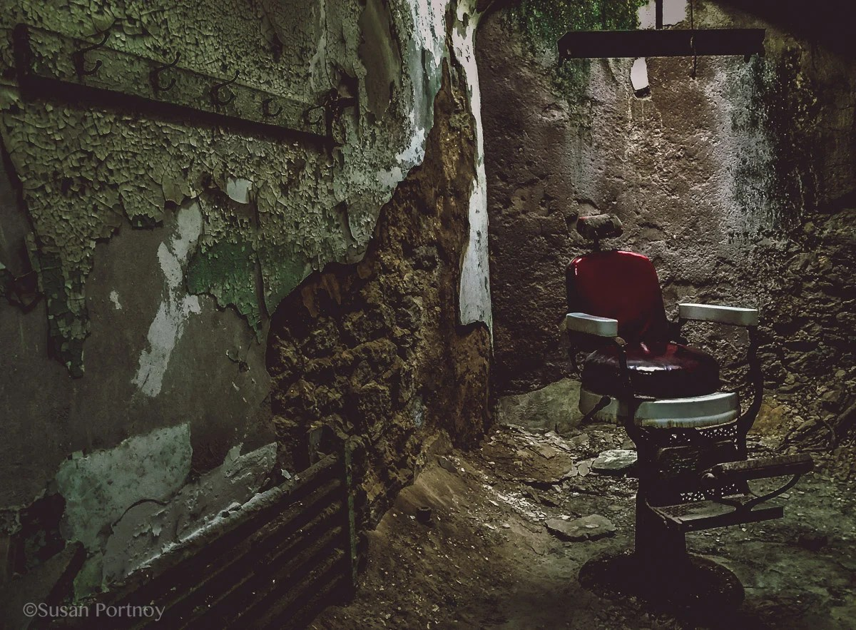 An old barber chair in a cell in Eastern State Penitentiary