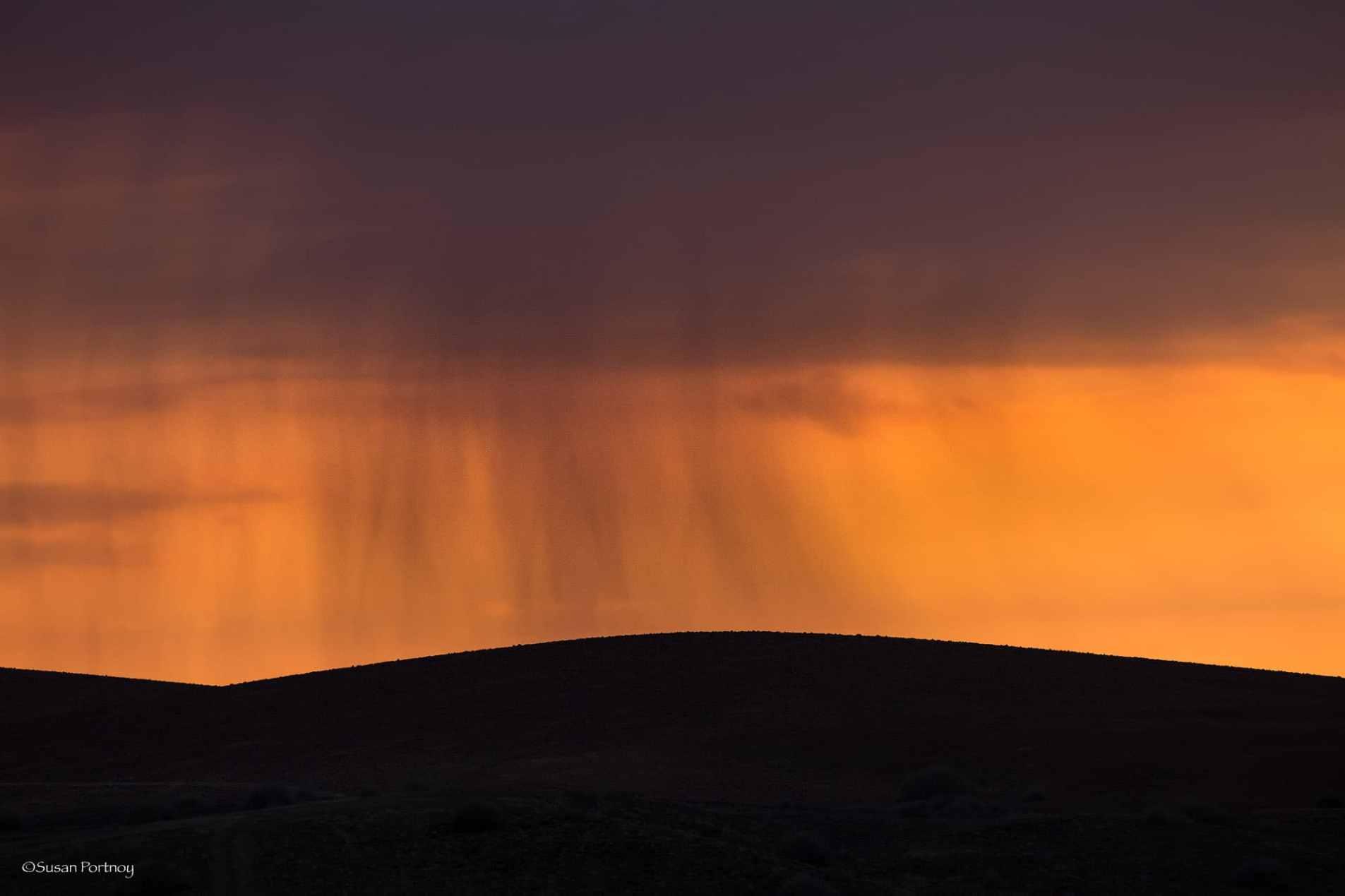 Whispy clouds that look like rain at sunrise near Desert Rhino Camp in Namibia