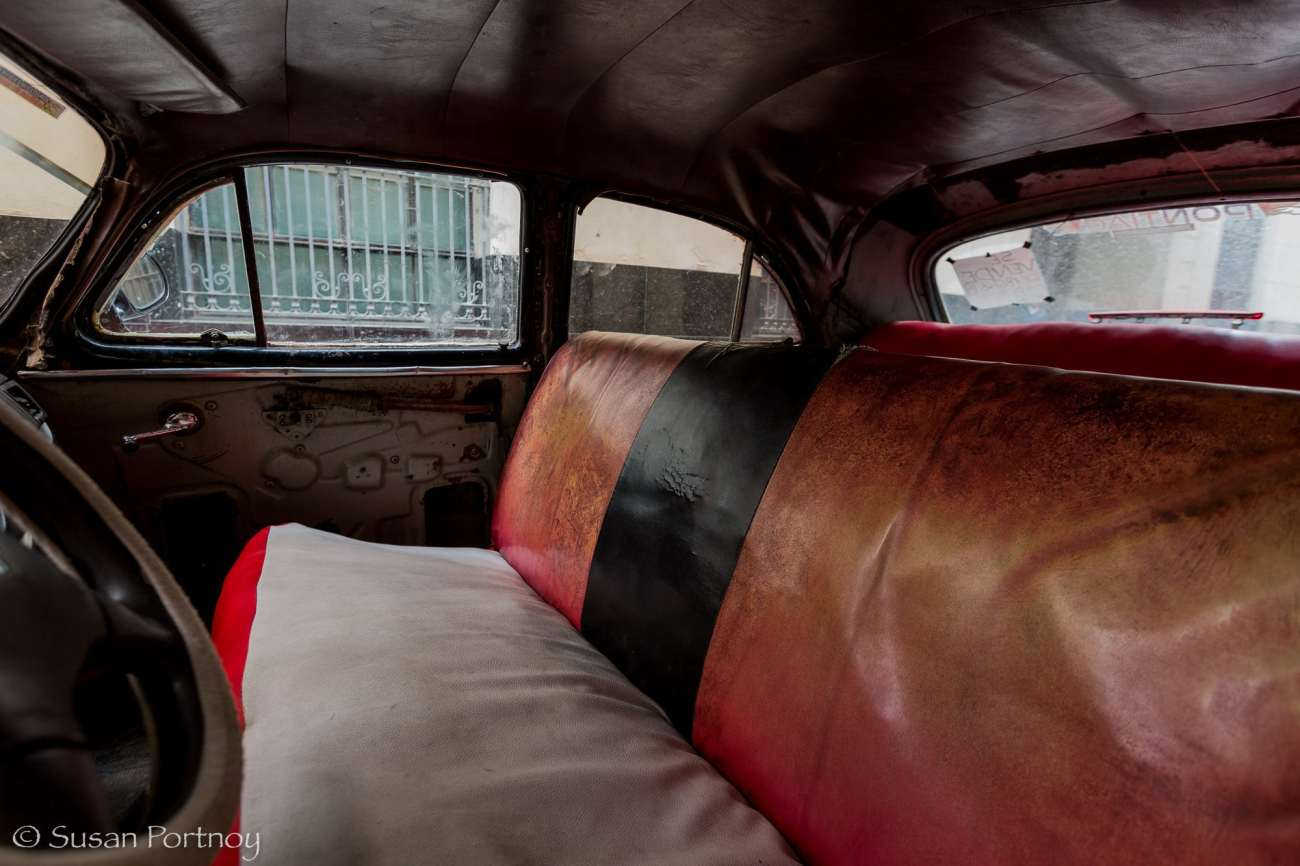 Front seats of red classic car in Havana, Cuba