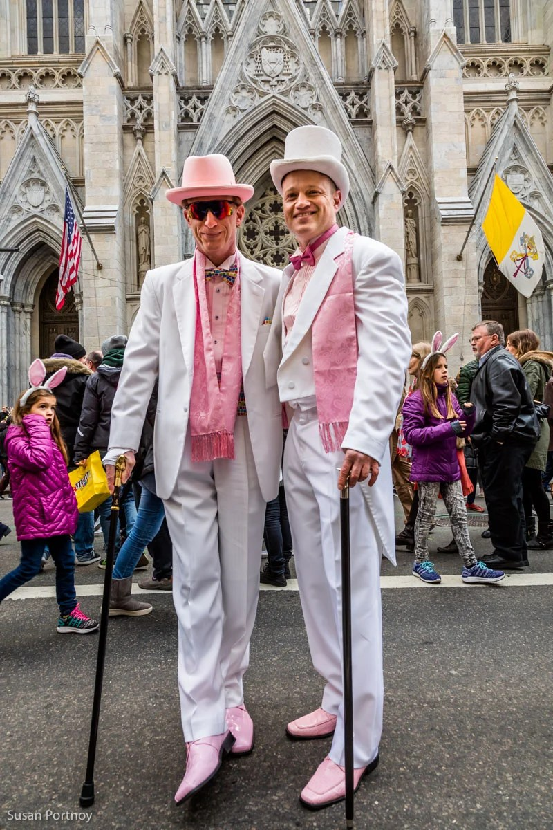 Two men in pink and white tophats and tails in the Easter Parade in NYC 2016