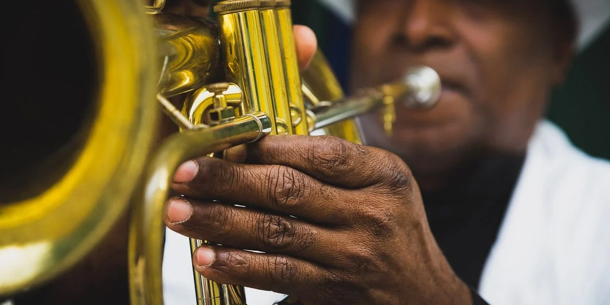 Photographing travel portrait of Man playing trumpet in Havana, Cuba