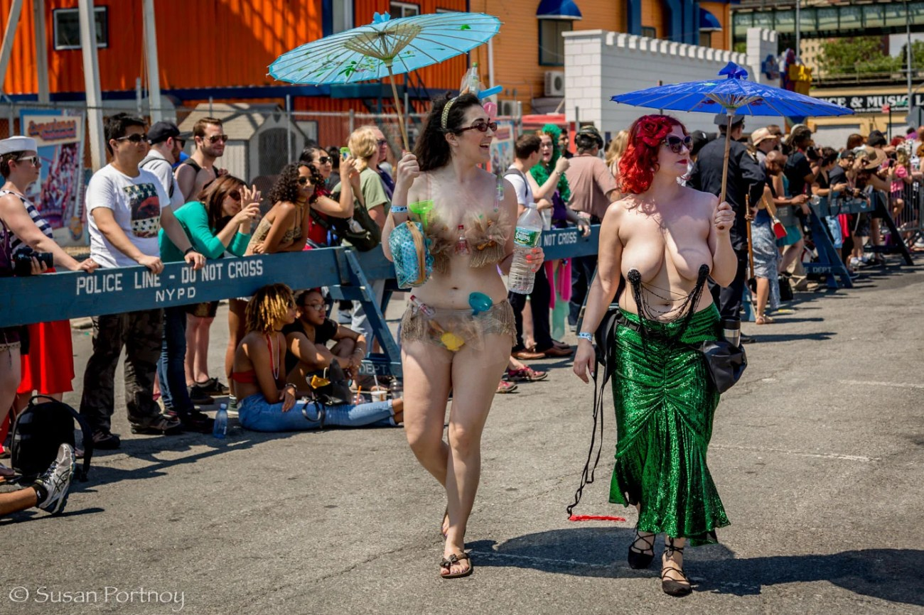 Two women dressed as mermaids at the Coney Island Mermaid Parade 2016