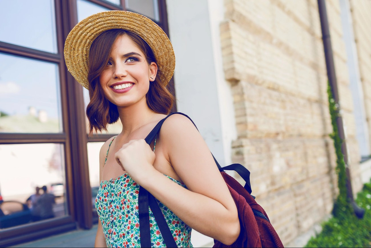 Woman happy traveling alone