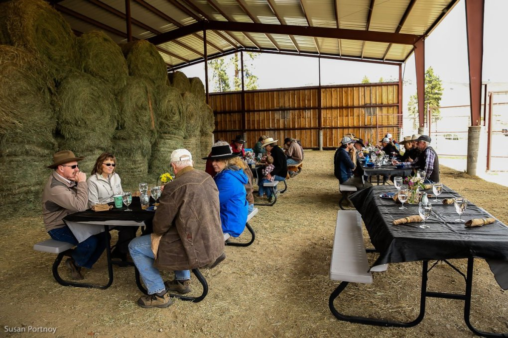 Guests, ranchers and staff eating after Spring cattle Branding Day at Triple Creek Ranch in Montana - The Insatiable Traveler