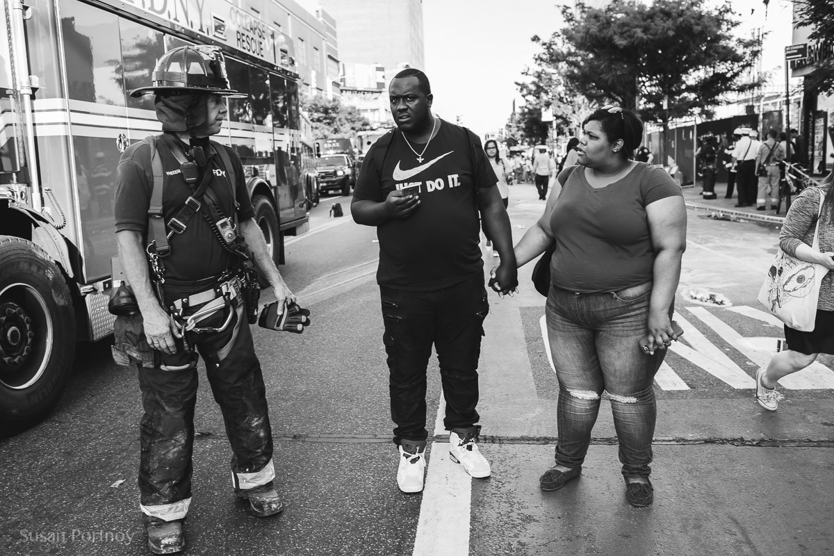 Couple and a fireman -- Peter Turnley Street Photography Workshop