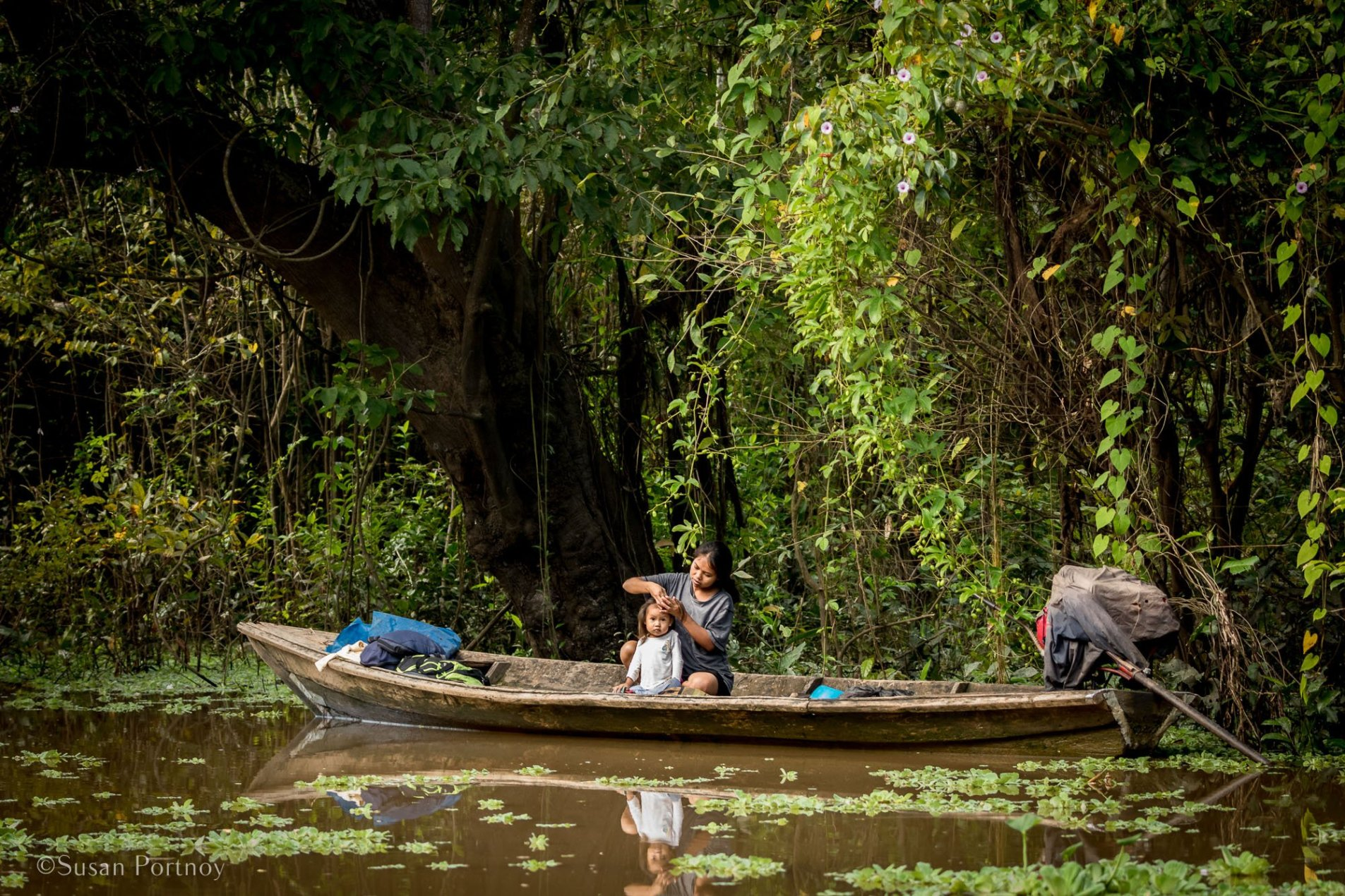 Woman in a boat   6 Things to love about a luxury River Cruise on the Amazon -0855