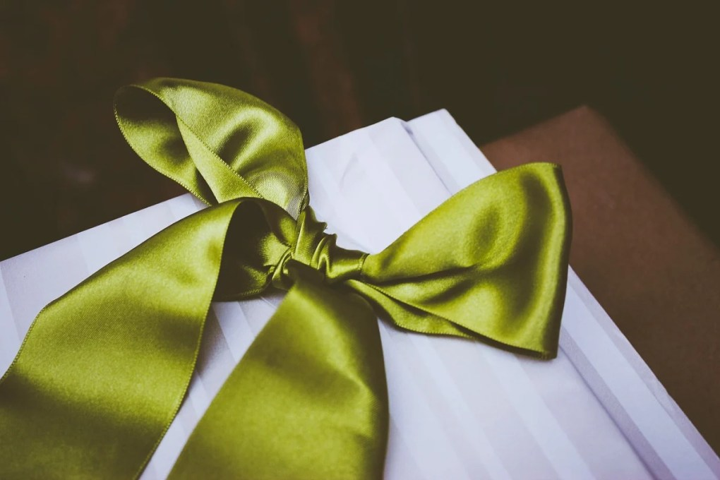Image of a gift box with a green bow