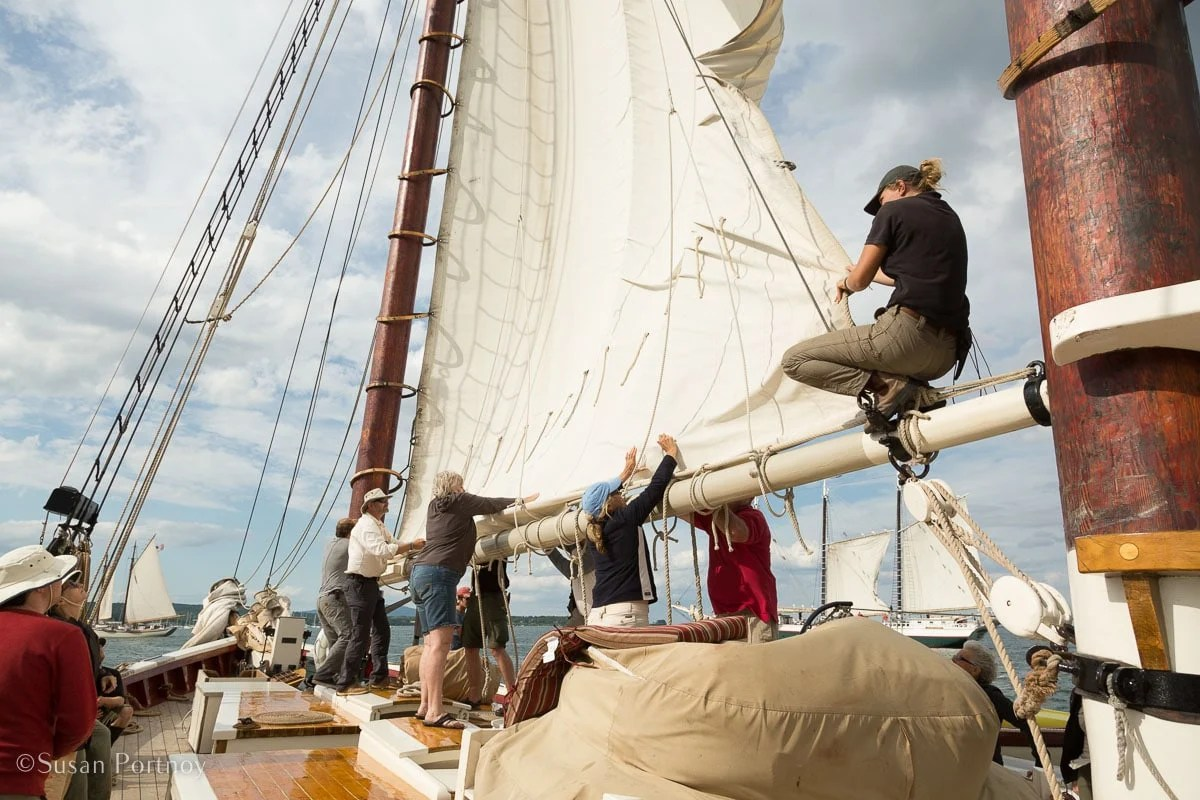 Guests and Crew stow the mainsail -- Windjammer cruise in Maine-720020180706