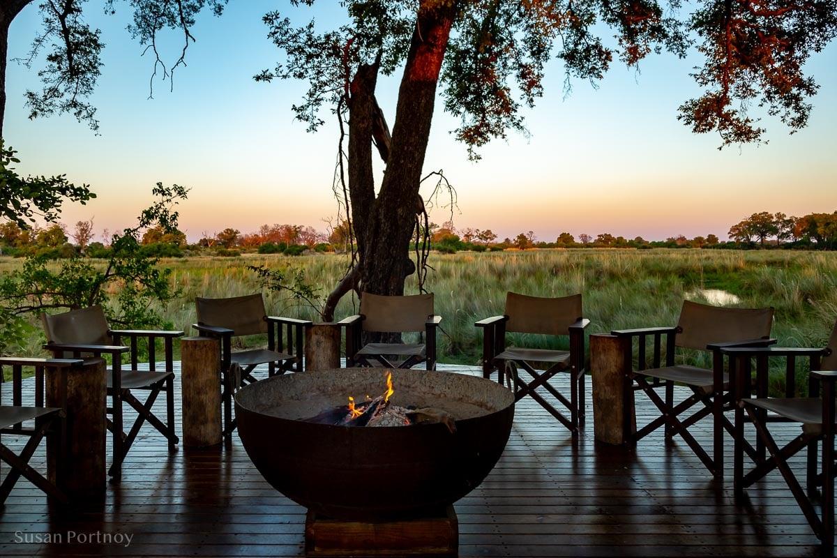 The fire pit on the main deck overlooking the bush - Duba Explorers Camp Okavango Delta, Botswana-978201