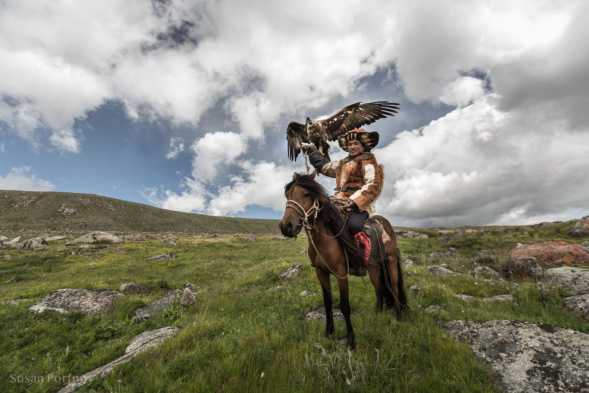 Shohan the eagle hunter on his horse with his eagle.