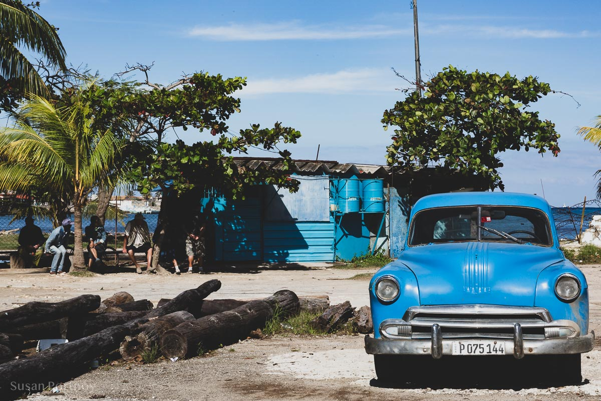 Marina with a blue car in Cojimar, Cuba